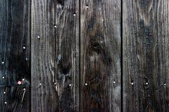 Oude zwarte geschilderde houten muur - textuur of achtergrond Stock Afbeeldingen