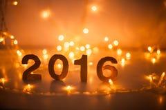 Oudejaarsavond, 2016, lichten, cijfers van karton worden gemaakt dat Royalty-vrije Stock Afbeelding