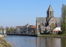 Oudenaarde Riverside. View of the river Schelde and church of Our Lady in Oudenaarde, East Flander, Belgium Royalty Free Stock Images