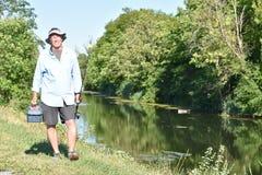 Oudere Hogere Volwassen Mannelijke Visser Outdoors With Fishing Rod Fishing royalty-vrije stock afbeeldingen