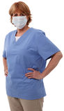 Oudere Verpleegster met Chirurgisch Masker Stock Foto