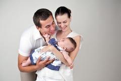 Ouders met een kind Stock Foto's