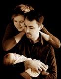 Ouders met pasgeboren baby in sepia royalty-vrije stock foto's