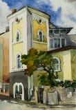 Ouderwets herenhuis met een toren en steenomheining Royalty-vrije Stock Afbeelding