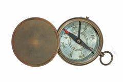 Ouderwets magnetisch kompas en deksel royalty-vrije stock afbeeldingen