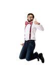 Ouderwetse mens die bretels het springen dragen stock foto's