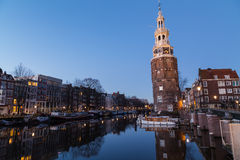 Oudeschans Canal and Montelbaanstoren Tower in Amsterdam Royalty Free Stock Photography