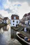 Historical houses along a canal in Oudewater in the Netherlands royalty free stock photo