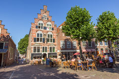 Oudewater The Netherlands. OUDEWATER, THE NETHERLANDS - AUG 17, 2016: People on a terrace in the center of the historical village Oudewater Stock Photography