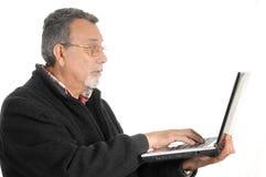 Oudste met laptop computer Royalty-vrije Stock Foto