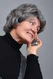 Oudste op de telefoon Stock Foto