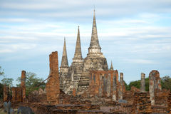 Сoudy morning on the ruins of the Buddhist temple of Wat Phra Si Sanphet. Ayuthaya, Thailand Royalty Free Stock Photo