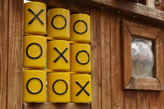 Oughts and crosses, tic tac toe game, at children playground.  Stock Photos
