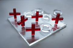 Oughts e cruzes de vidro imagens de stock royalty free