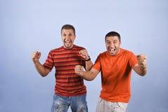 Oui ! Nous avons gagné ! Types Excited avec des mains vers le haut Photographie stock libre de droits