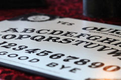 Ouija Board. Letters on an Ouija board or planchette Stock Photos