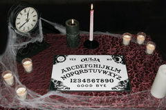 Ouija board with candles Stock Images