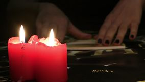 Ouija Board Talking with Spiritual Powers Mystic Concept. Evil works in candle light stock video footage