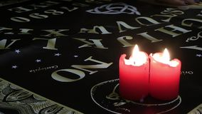 Ouija Board Talking with Spiritual Powers Mystic Concept. Evil works in candle light stock video