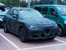 Oulx, Italy _ October  01, 2016 Prototype of a SUV car camouflaged testing on the road Royalty Free Stock Photos