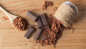 Ounces of chocolate and pure cocoa powder from above royalty free stock photos