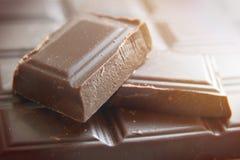 Ounces of dark chocolate. On a chocolate bar Royalty Free Stock Photos