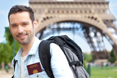 Oung attractive traveler in Paris with passport Stock Image