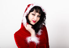 Oung and beautiful woman in red coat holding a nice Christmas present box Stock Photography