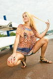 Oung blondy woman standing in front of  yacht Royalty Free Stock Photography