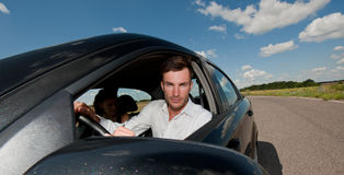 Oung businessman in the car Royalty Free Stock Photos