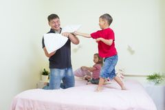 Oung Caucasian Family Having a Playful Funny Pillow Fight Royalty Free Stock Photos