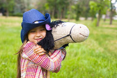 Oung cowboy shirt and a toy horse Royalty Free Stock Photography