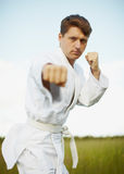 Нoung man is engaged in karate Royalty Free Stock Image