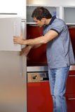 oung man looking in refrigerator Stock Image