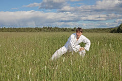 Нoung man practices Wushu in field Stock Image