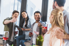 Oung people partying, drinking wine. Young people partying, drinking wine at home party Stock Image