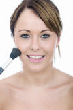 Oung Woman Applying Face Powder Stock Photography