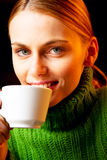 Oung woman drinking cappuccino Royalty Free Stock Photography