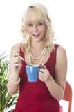 Oung Woman Drinking Coffee Stock Image