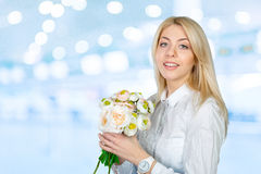 Oung woman with flowers Royalty Free Stock Images