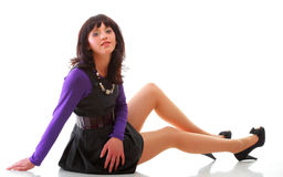 Oung woman girl lying on the floor isolated Royalty Free Stock Image
