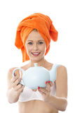 Oung Woman Holding a Teapot Stock Photo