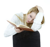 Oung woman reading book Stock Photography