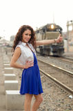 Oung woman thumbing a ride on a train Royalty Free Stock Image