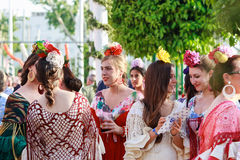 Oung women wearing traditional flamenco dress at the April Fair Seville Stock Photo