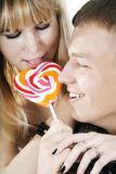 Сouple eating lollypop Royalty Free Stock Images