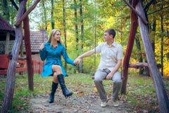 Сouple enjoying golden autumn fall season Royalty Free Stock Images