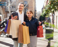 Ouple in jackets with purchases Stock Images