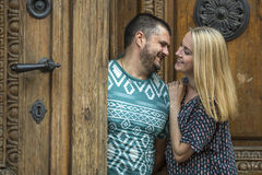 Сouple in love hugging while standing next to an ancient doors. Royalty Free Stock Images