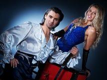 Ouple performing sword box illusion. Attractive couple performing sword box illusion stock image